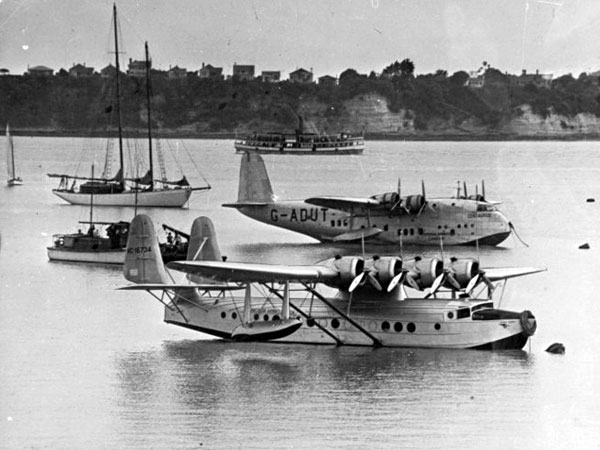 Pan American Airways Sikorsky flying boat 'Samoan Clipper' (foreground), and Imperial Airways flying boat 'Centaurus', moored off the Pan-American wharf  at Mechanics Bay, Auckland, between 26 December, 1937 and 1 January, 1938.