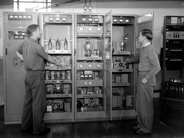 Two unidentified men checking transmitters Auckland Radio, 29 August 1946. Photo: Whites Aviation