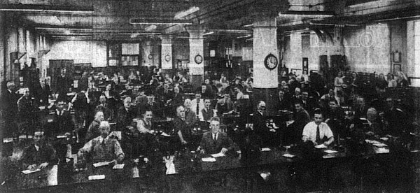 Morse operators at their stations in the telegraph room of the Auckland Chief Post Office in 1948
