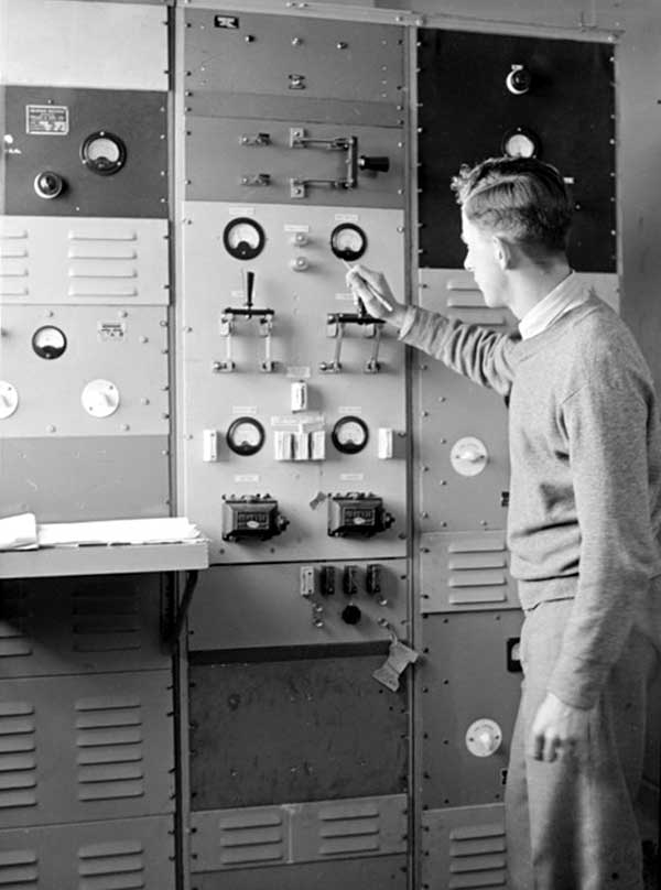 BV Richards checks transmission instruments at  Musick Point Air Radio Station