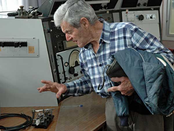 Former radio inspector Jack Sullivan examines a semi-automatic key.
