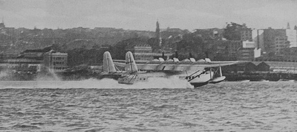 """Just after she made a beautiful landing on the Waitemata Harbour: The Clipper moving along in a smother of foam."""