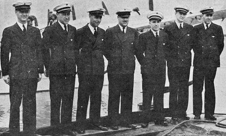The crew of the Clipper photographed at San Francisco just before the machine took off. From left: Mssrs Parker, mechanic; WM Holsenbeck, mechanic; R Runnells, wireless operator; V Wright, engineer; H Canaday, navigator; R Briggs, first officer; Captain Edwin C Musick, commander.