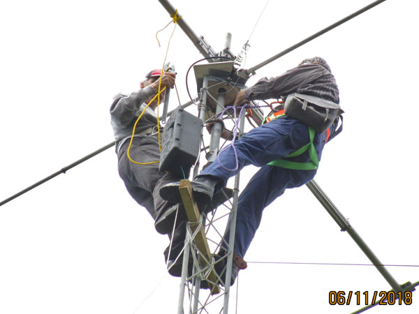 Harry (left) and Steve working at the top of the East Tower