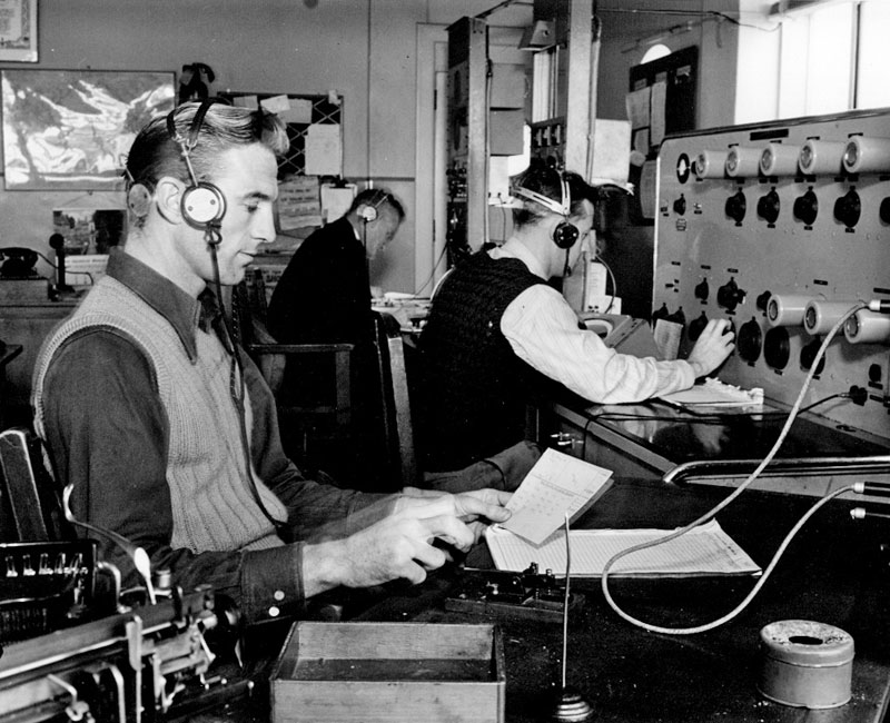 Operators Norm Ashwell (aircraft watch), Jim Clark (DF) and Henry Putt (500kHz shipping) at Auckland Radio ZLD, probably in the 1940s
