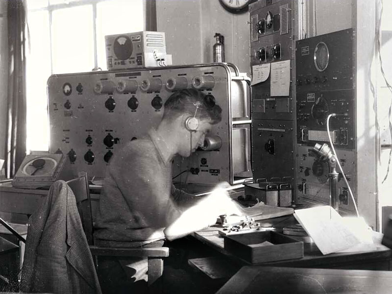 Radio operator EW Ritchie, working at the Musick Point Air Radio Station, 29 Aug 1946