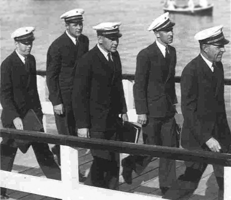 Captain Edwin Musick leads four of his six officers ashore in Auckland, 26 Dec 1937