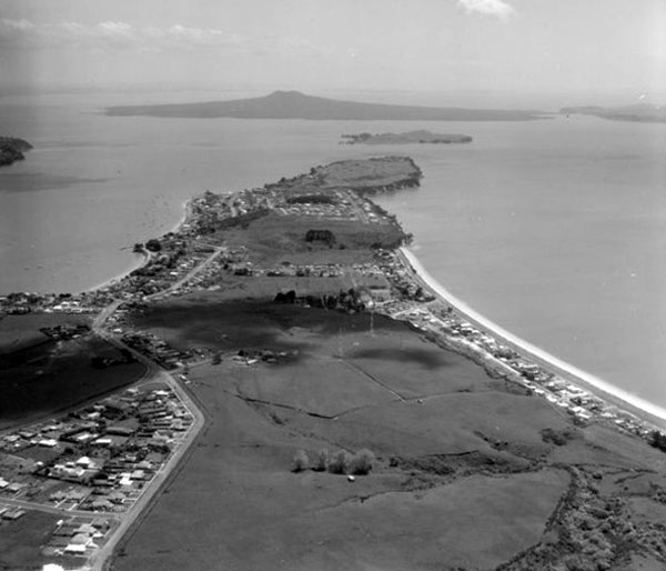 Looking north over Bucklands Beach and Musick Point, with Rangitoto Island and Browns Island in the distance, 27 October 1964.