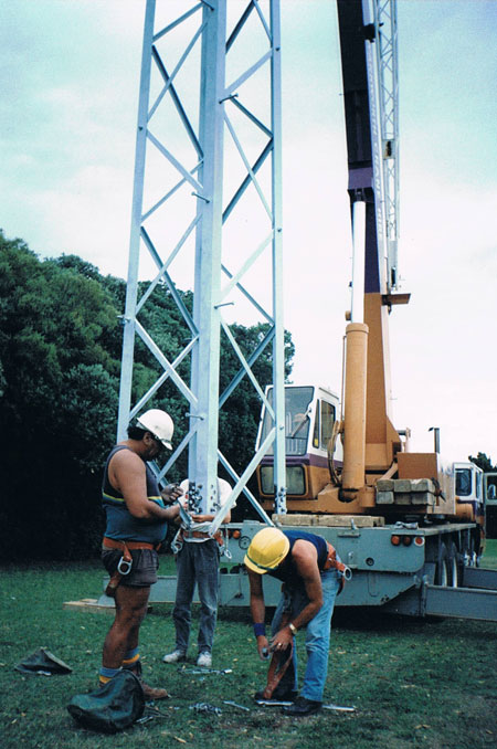 Riggers prepare for the lowering of the tower