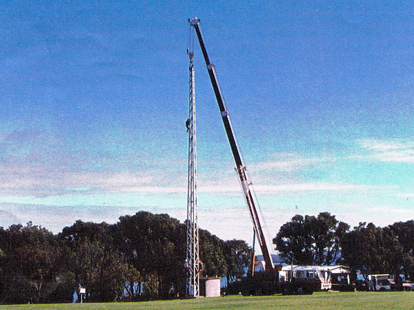 The crane takes the strain as the rigger descends the tower.