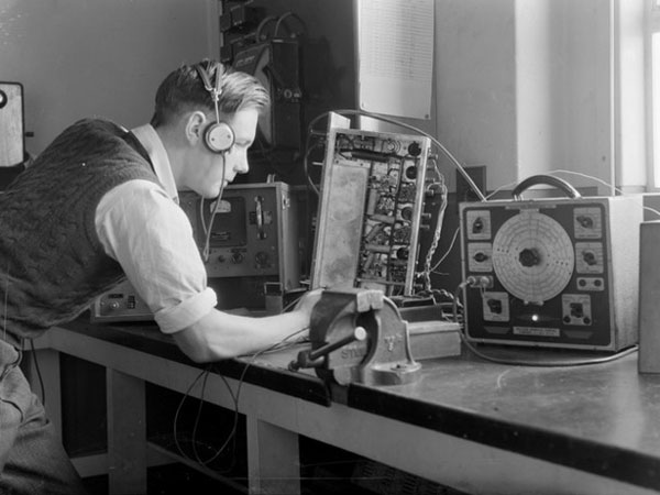 N Grewell-Cooke, testing a receiver at, Musick Point Air Radio Station, Auckland, 29 August 1946