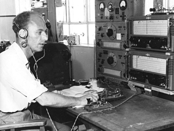 Mac MaClaren using a 'bug' key in the main CAA comms room. I cannot date this photo but it predates the one above. The Eddystone receivers are very new, being still in cabinets. There's a remote control (with telephone dial) for one of the Collins auto-tune transmitters and a couple of HRO-copy receivers, type 941 I think.