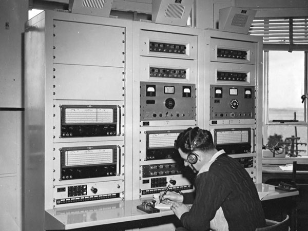 This is a close-up of the right hand racks seen in the photo above. The receivers were used for the NZ local communications network to regional airfields. At the left are two Eddystone S680X receivers, which replaced Collier & Beale versions of National HRO receivers. The middle and right hand racks each have a pair of Australian-built Thom & Smith fixed frequency receivers at the top, then remote controls for Collins auto-tune transmitters, another Eddystone, and switching panels at desk level. All operations were CW (Morse Code).