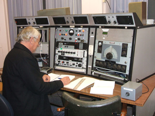 Paul ZL1BBR at the 630m desk. The remote control for the Dansk transmitter is at the top of the centre bay, above three receivers
