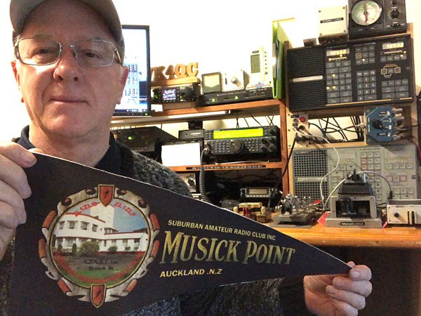 Peter Hewitson VK4QC displays the Musick Point pennant in recognition of his Trans Tasman contact with ZL1ZLD.