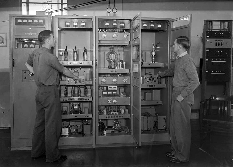 Ron Turner and Keith Bone with a 3kW Collins 12-channel auto-tune transmitter