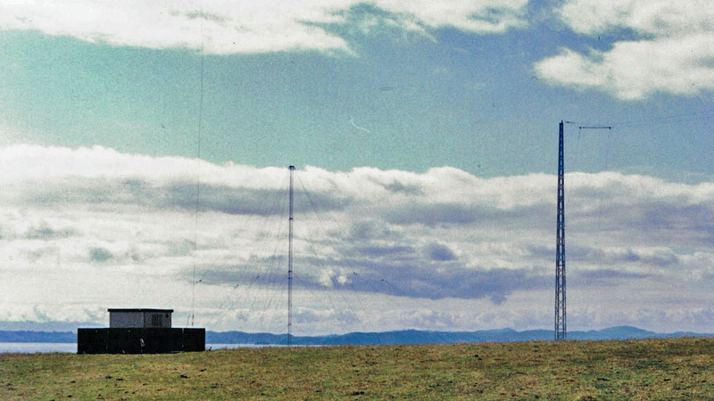 Conical monopole (centre) and Marconi Tee aerial at Auckland Radio ZLD transmitter site